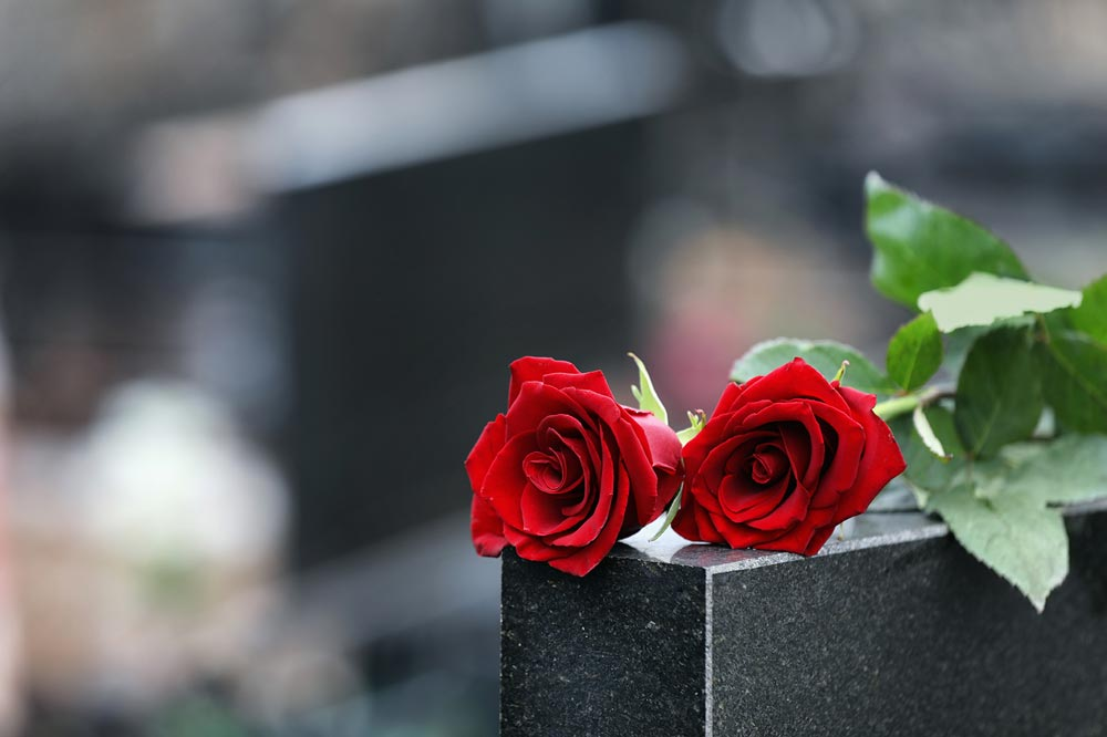 Roses on Grave after Wrongful Death Accident